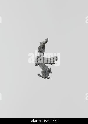 Statuette of a sphinx, 5. Culture: Greek, Laconian. Dimensions: Height: 1 in. (2.5 cm). Museum: Metropolitan Museum of Art, New York, USA. - Stock Photo