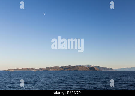 A view from the sea of the island of Corsica in the mediterranean sea in France - Stock Photo