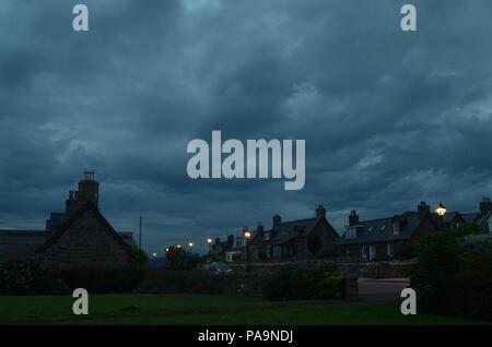 Dark clouds over the village of Golspie, Scotland - Stock Photo