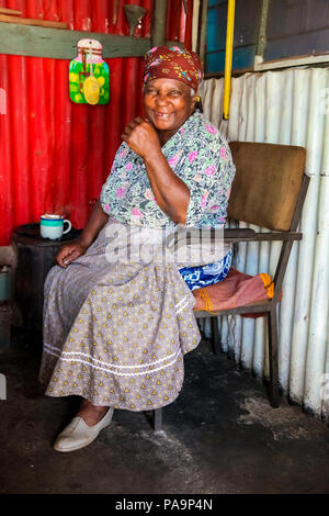 Johannesburg, South Africa, September 11, 2011, Sweet old African Lady in low-income Soweto home - Stock Photo