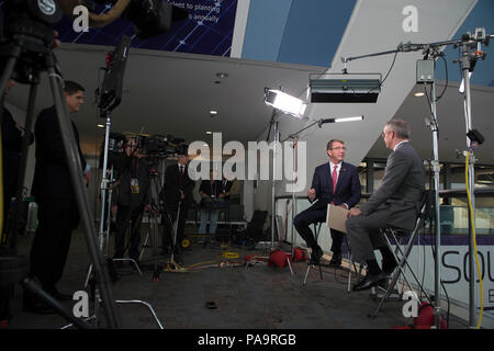 Secretary of Defense Ash Carter is interviewed by CNBC's Eamon Javers at the 2016 RSA conference in San Francisco, March 2, 2016. Carter is in San Francisco to strengthen ties between the Department of Defense and the tech community (DoD photo by Navy Petty Officer 1st Class Tim D. Godbee)(Released) - Stock Photo