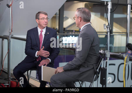 Secretary of Defense Ash Carter is interviewed by CNBC's Eamon Javers at the 2016 RSA conference in San Francisco, March 2, 2016. Carter is in San Francisco to strengthen ties between the Department of Defense and the tech community. (DoD photo by Navy Petty Officer 1st Class Tim D. Godbee)(Released) - Stock Photo