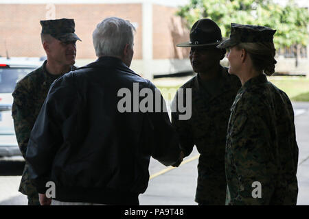 Secretary of the Navy Ray Mabus, left, shakes hands with U.S. Marine Corps Sgt. Maj. Donna A. Dunbar, sergeant major, 4th Recruit Training Battalion, Marine Corps Recruit Depot Parris Island (MCRDPI), at the 4th Recruit Training Battalion building aboard MCRDPI, S.C., March 3, 2015. Mabus visited MCRDPI in order to see firsthand how young men and women from across the country are transformed into United States Marines. (U.S. Marine Corps photo by Lance Cpl. Colby Cooper/Released) - Stock Photo