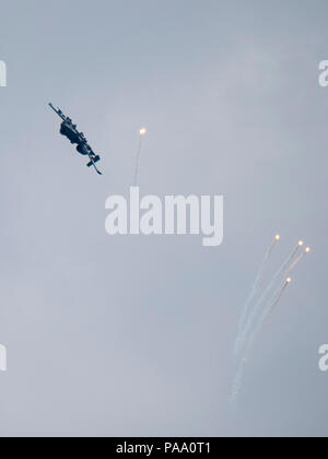 An A-10 Thunderbolt II releases flares over Grand Bay Bombing and Gunnery Range at Moody Air Force Base, Ga., March 4, 2016. Multiple U.S. Air Force aircraft within Air Combat Command conducted joint aerial training that showcased the aircraft's tactical air and ground maneuvers, as well as its weapons capabilities. (U.S. Air Force photo by Staff Sgt. Brian J. Valencia/Released) - Stock Photo