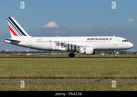 Air France A320-200 with registration F-GKXL just landed on runway 18R (Polderbaan) of Amsterdam Airport Schiphol. - Stock Photo