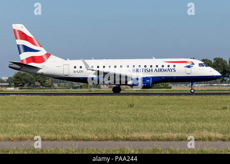 British Airways Embraer ERJ-175 (BA Cityflyer) with registration G-LCYI just landed on runway 18R (Polderbaan) of Amsterdam Airport Schiphol. - Stock Photo
