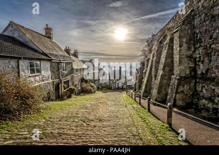 Famous Gold Hill in Shaftesbury with sun in sky taken in Shaftebury, Dorset, UK on 3 January 2017 - Stock Photo