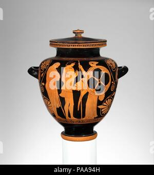Terracotta stamnos (jar). Culture: Greek, Attic. Dimensions: H. 16 in. (40.7 cm); width with handles  14 5/8 in. (37.2 cm); H. without cover  14 3/16 in. (36.1 cm). Date: ca. 470-460 B.C..  Obverse, warrior arming, possibly Achilles  Reverse, Menelaos reclaiming his wife, Helen  The subject matter of the obverse is indicated by the woman who is handing the warrior his armor. In Homer's Iliad, Thetis, the mother of Achilles, replaces the original armor that Achilles gave to his friend Patroklos. This side probably depicts the principal Greek hero of the Trojan War, while the other indicates the - Stock Photo