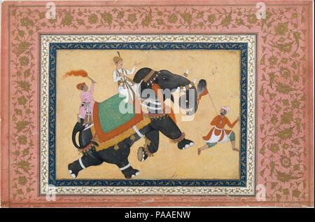 Prince Riding an Elephant. Artist: Painting by Khem Karan. Dimensions: Page: H. 12 1/4 in. (31.1 cm)  W. 18 1/2 in. (47 cm)  Painting: H. 7 3/4 in. (19.7 cm)  W. 10 3/4 in. (27.3 cm)  Mat: H. 19 1/4 in. (48.9 cm)   W. 14 1/4 in. (36.2 cm). Date: 16th-17th century.  Elephants were highly prized at Indian courts, greatly appreciated as gifts, and eagerly sought as booty in military campaigns. Paintings of several admired elephants were made at the Mughal court, much as portraits were made of courtiers and nobles. Khem Karan, whose signature appears at the bottom of the picture, was a well-known  - Stock Photo