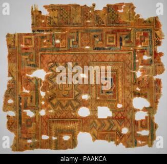 Fragment. Dimensions: Rug: L. 40 3/16 in. (102 cm)  W. 46 1 1/6 in. (117 cm). Date: 4th-5th century.  This rug fragment is a rare example of an early textile that most certainly functioned as a floor covering. Its brilliant colors, interlocking designs, and shaded geometric forms create an illusionistic effect. The overall design of the fragment is directly linked to decorative floor patterns on Christian mosaic pavements found throughout southern and eastern Mediterranean lands. The cut-loop technique seen here had been used for centuries in Egypt. Museum: Metropolitan Museum of Art, New York - Stock Photo