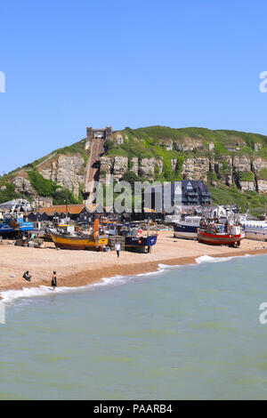 The beach and fishing boats at Hastings, the historical, coastal town on the south coast, in East Sussex, UK - Stock Photo