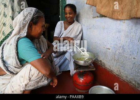 Indian Hindu widows cooking in ashram in Vrindavan , India - Stock Photo