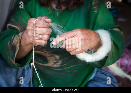 Qashqai woman weaving wool for marking rugs and carpets, nomad people, Iran - Stock Photo