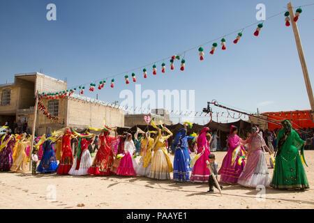 Qashqai traditional dances during wedding ceremony, nomad people, Iran - Stock Photo