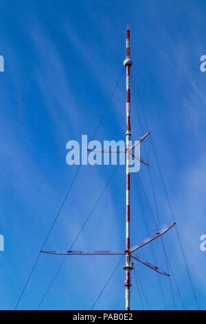 Telecomunacition television, radio antenna, satellite tower against blue sky background. - Stock Photo