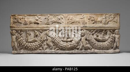 Marble sarcophagus with garlands and the myth of Theseus and Ariadne. Culture: Roman. Dimensions: Overall: 31 x 85 3/4 x 28in. (78.7 x 217.8 x 2.3 cm). Date: ca. A.D. 130-150.  On the lid, shown in delicate low relief, winged erotes drive chariots drawn by animals associated with the four seasons: bears with spring, lions with summer, bulls with fall, and boars with winter. On the front, four erotes bear seasonal garlands composed of flowers, wheat, grapes, pomegranates, and laurel. Between the swags are three episodes from the myth of the Greek hero Theseus. With the help of the Cretan prince - Stock Photo