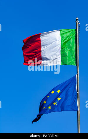 Italian and European Union flags fly over Rome - Stock Photo
