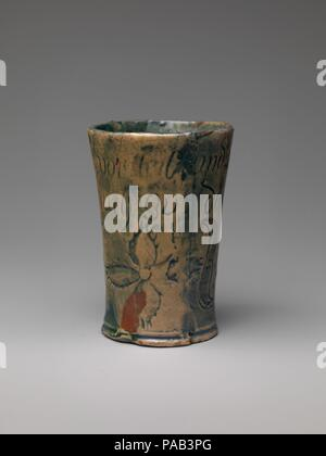 Tumbler. Culture: American. Designer: Henry Chapman Mercer (1856-1930). Dimensions: H. 5 in. (12.7 cm). Manufacturer: Moravian Pottery and Tile Works (founded in 1899). Date: ca. 1879. Museum: Metropolitan Museum of Art, New York, USA. - Stock Photo