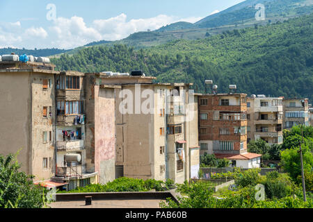 Typical old communist era apartment blocks of poor quality in the town of Memaliaj in Southern Albania. - Stock Photo