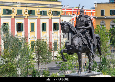 The Statue of Skanderbeg at the centre of Skanderbeg Square with the Government offices in the background, Tirana, Albania, - Stock Photo