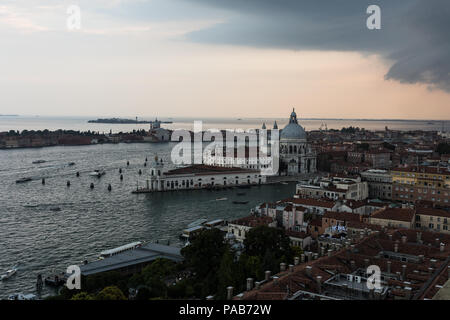 Threatening sky over the Grand Canal and the famous  basilica di santa maria della salute in Venice old town in north italy. - Stock Photo