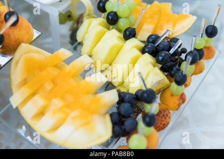Feautiful fruit buffet served for guests at wedding. - Stock Photo