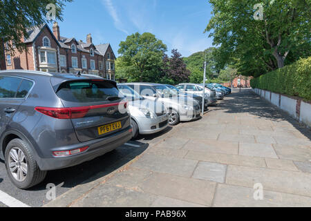 Row of cars parked at right angles to the pavement in a side street in Lytham, Lancashire - Stock Photo
