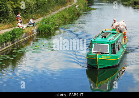 Canal Boat Egremont   operated by Chichester Canal Trust  approaching Hunston Bridge from Chichester Summer  West Sussex - Stock Photo
