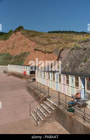 Jacobs Ladder beach at Sidmouth a seaside resort in East Devon, England UK. Changing chalets on the esplanade. - Stock Photo