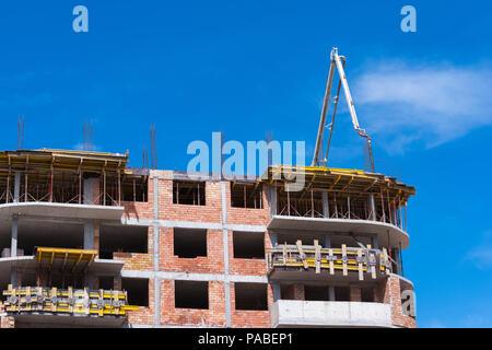 Construction building works with automobile concrete pump. - Stock Photo