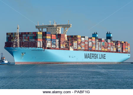 The Manchester Maersk is arriving in the port of Rotterdam - Stock Photo