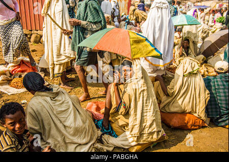 OMO, ETHIOPIA - SEPTEMBER 19, 2011: Unidentified Ethiopian girl with umbrella. People in Ethiopia suffer of poverty due to the unstable situation - Stock Photo