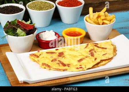Fried Egg and Sausage in a pan - Sahanda Yumurta - Stock Photo