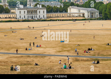 Greenwich Park, South East London, UK, in the summer heatwave of 2018, with parched grass and crowds - Stock Photo