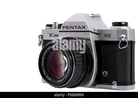 Pentax K1000 SE with SMC-M 50mm f/1.4 Lens on White Background, Product Photo, Vintage Film Camera - Stock Photo