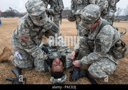 U.S. Army Reserve Officers' Training Corps cadets from Clemson University learn how to clear an airway during a First Aid training lab, March 3, 2016. (U.S. Army photo by Staff Sgt. Ken Scar) - Stock Photo