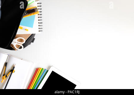 Back to school. Items for the school colourful supplies on white table ready for your design - Stock Photo