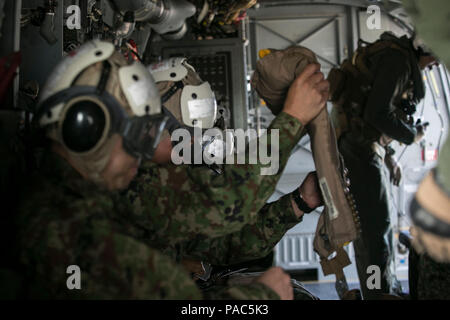 Japan Ground Self-Defense Force service members prepare for a flight on an MV-22B Osprey by putting on cranials to protect their head and ears, as well as an inflatable vest in case of emergency over a body of water, during their visit to Marine Corps Air Station Futenma, Okinawa, Japan, March 8, 2016. U.S. Marine crew chiefs give safety briefs to their passengers before each flight, explaining emergency exits, evacuation steps. The Japanese service members visited MCAS Futenma to strengthen relations in the Asia-Pacific and to view the capabilities of the Osprey firsthand. The Osprey is with