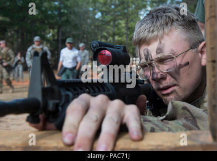 U.S. Air Force Senior Airman Eric Mann, 1st Combat Camera combat broadcaster, learns how to fire an M4 rifle while bounding forward during exercise Scorpion Lens, March 9, 2016 at Fort Jackson, S.C. Combat Camera airmen and soldiers practiced maneuvering and firing first without ammo, then blanks, and a final run with live ammo hitting popup targets. (U.S. Air Force photo by Staff Sgt. Perry Aston) - Stock Photo