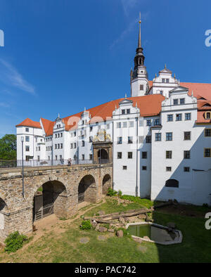 Castle view from the west with Schlossbrücke, Bärenzwinger, portal and coat of arms, Schloss Hartenfels in Torgau, Saxony - Stock Photo