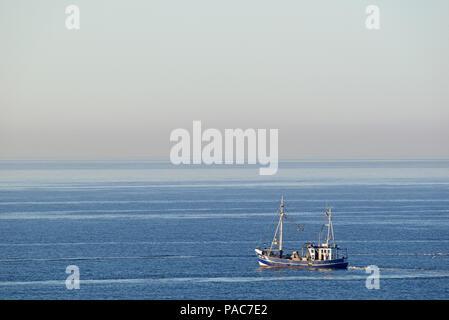 Trawler on fishing trip near Norderney, North Sea, East Frisian Islands, Lower Saxony, Germany - Stock Photo