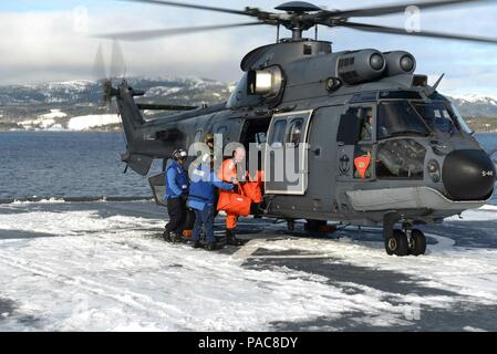 160308-N-AH771-154 NAMSOS FJORD, Norway (March 8, 2016)  Dutch Naval officers come aboard the Whidbey Island-class dock landing ship USS Fort McHenry (LSD 43) to meet with Cmdr. Michael R. Johnson, the commanding officer and Lt. Col. David Baas, the commander of troops for 2nd Assualt Amphibian Battalion. Fort McHenry is currently participating in Exercise Cold Response 2016, which is a biennial Norwegian invitational that tests militaries' ability to operate in extreme cold weather conditions. (U.S. Navy photo by Mass Communication Specialist Seaman Apprentice Daniel C. Coxwest/Released) - Stock Photo