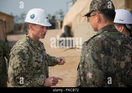 160314-N-HA376-039 BUSAN, Republic of Korea (March 14, 2016) - U.S. Navy Capt. James Meyer, commodore, 30th Naval Construction Regiment (30 NCR), speaks with Republic of Korea (ROK) Navy Cmdr. Lee Young Suk during a tour of a joint U.S. and ROK construction site during exercise Foal Eagle 2016. 30 NCR is forward deployed to provide command and control of U.S. Navy Seabees working with their ROK counterparts during Foal Eagle. Foal Eagle is an annual, bilateral training exercise designed to enhance the readiness of U.S. and ROK forces, and their ability to work together during a crisis. (U.S. N - Stock Photo