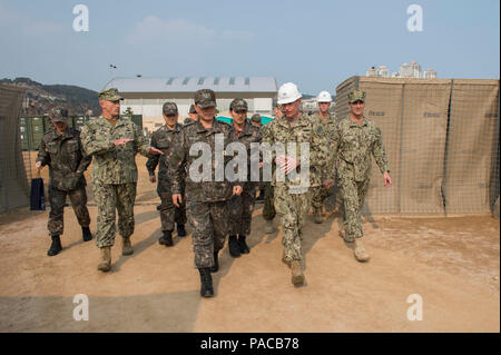 160314-N-HA376-197 BUSAN, Republic of Korea (March 14, 2016) - U.S. Navy Capt. James Meyer, commodore, 30th Naval Construction Regiment, speaks with Commander Republic of Korea (ROK) Fleet Vice Adm. Lee, Ki-sik, during a tour of a joint U.S. and ROK construction site during exercise Foal Eagle 2016. Lee visited the site to see the various expeditionary facilities built by U.S. Navy and ROK Seabees during the exercise. Foal Eagle is an annual, bilateral training exercise designed to enhance the readiness of U.S. and ROK forces, and their ability to work together during a crisis. (U.S. Navy phot - Stock Photo