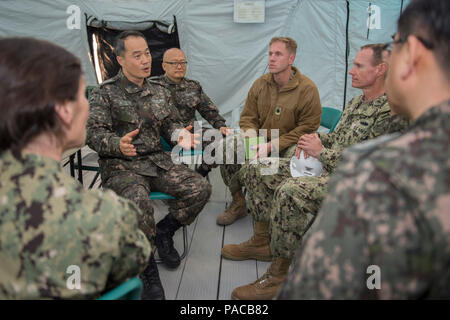 160314-N-HA376-494 BUSAN, Republic of Korea (March 14, 2016) - Republic of Korea (ROK) Navy Capt. Jung, Minh-wan, ROK engineering bureau chief, speaks about further U.S. and ROK engagements with Capt. James Meyer, commodore, 30th Naval Construction Regiment (30 NCR) and Cmdr. Ross Campbell,  30 NCR operations officer, during exercise Foal Eagle 2016.  30 NCR is forward deployed to provide command and control of U.S. Navy Seabees working with their ROK counterparts during Foal Eagle. Foal Eagle is an annual, bilateral training exercise designed to enhance the readiness of U.S. and ROK forces, a - Stock Photo