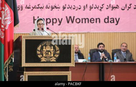 Rula Ghani, first lady of Afghanistan, speaks during the Ministry of the Interior International Women's Day celebration in Kabul, Afghanistan. She said that women serving in the Ministries and the Interior play a major role in defending the country and preserving the rights of all citizens of Afghanistan. She commended the women in the audience for defending the interests of Afghanistan, as well as its independence. (U.S. military photo by Lt. Charity Edgar/Released) - Stock Photo