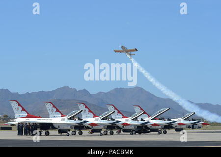 Joe Shetterly, Van's RV-8 pilot, performs an aerobatic demonstration over five U.S. Air Force Air Demonstration Squadron F-16 Fighting Falcons during the Thunder and Lightning over Arizona Open House event at Davis-Monthan Air Force Base, Ariz., March 13, 2016. The open house featured aerial demonstrations from various teams and numerous static displays allowing the public to gain a better understanding of the Air Force. (U.S. Air Force photo by Senior Airman Chris Massey/Released) - Stock Photo