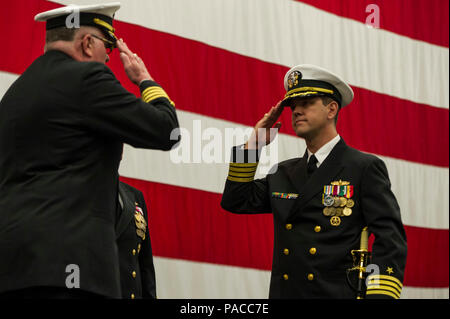 160311-N-FR671-089  SAN DIEGO (March 11, 2016) Capt. Clinton A. Carroll, left, turns over command to Capt. Homer R. Denius III, right, during a change of command ceremony for Commander, Amphibious Squadron (COMPHIBRON) 3 held on board the amphibious assault ship USS America (LHA 6). COMPHIBRON 3 is currently embarked aboard America overseeing the final stages of the ship's post-shakedown availability. (U.S. Navy photo by Mass Communication Specialist 2nd Class Jonathan A. Colon/Released) - Stock Photo