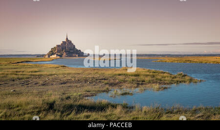 Mont Saint-Michel and surroundings in early morning sunligh in Normandy, France. - Stock Photo
