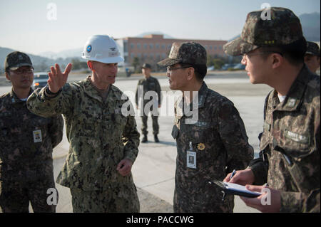 160315-N-HA376-573 JINHAE, Republic of Korea (March 15, 2016) - U.S. Navy Capt. James Meyer, commodore, 30th Naval Construction Regiment (30 NCR), speaks with Republic of Korea (ROK) Navy Vice Adm. Jung, Jin-soep, during exercise Foal Eagle 2016. 30 NCR is forward deployed to provide command and control of U.S. Navy Seabees working with their ROK counterparts during Foal Eagle. Foal Eagle is an annual, bilateral training exercise designed to enhance the readiness of U.S. and ROK forces, and their ability to work together during a crisis. (U.S. Navy photo by Chief Mass Communication Specialist  - Stock Photo